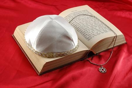 magen: Jewish holiday still life with torah,david star and kippah on red silk