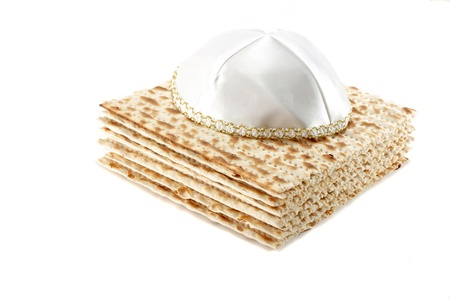 Jewish Passover holiday still life with matzoh and kippah on white background Stock Photo - 8374110