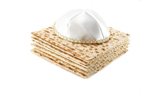 Jewish Passover holiday still life with matzoh and kippah on white background Stock Photo - 8374110