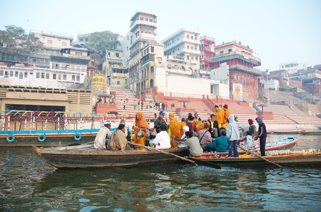 Varanasi, India,December 20,2007-Hindus perform ritual puja at dawn in the Ganges River on December 20, 2007 in Varanasi, India