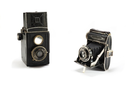 Two old film photo cameras on white background,isolated photo