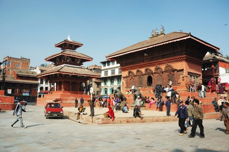 annually: Kathmandu,Nepal,December 15,2008 - Old Durbar Square with pagodas. Old Durbar Square is one of the most popular  tourist attractions in Asia, receiving millions of visitors annually
