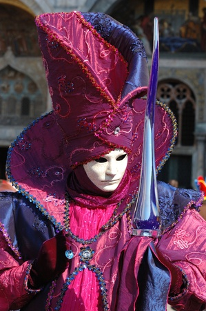 Venice,Italy, March 8,2011- Lady in costume at St. Mark's Square during the Carnival of Venice,the annual carnival was held in 2011 from February 26th to March 8th. Stock Photo - 9095042