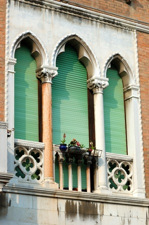 Old green lancet Venetian window,Italy photo