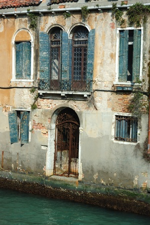 Old beautiful Venice house on the water, Italy photo