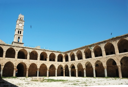 Ottoman landmark building - Khan El-Umdan in Akko, Israel .Akko -maritime capital of crusaders kindom photo