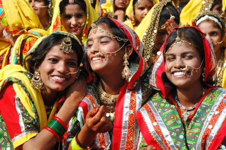 Pushkar,India,November 21,2012 - Rajasthani girls are preparing to dance perfomance at annual camel fair holiday in Pushkar,Rajasthan,India.Pushkar camel fair - one of the most popular attracitons in India