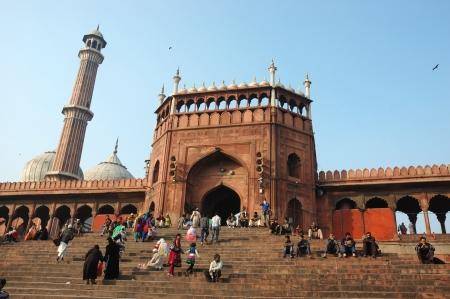 jama mashid: Delhi, India, November 18,2012 - worshippers are walking on courtyard of Jama Masjid Mosque - main mosque of Old Delhi Editorial