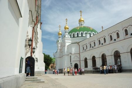 worshiper: Kiev, Ukraine,May 20,2012 -  tourists are visiting Kiev Pechersk Lavra - national historic-cultural sanctuary (monastery) and unesco heritage site