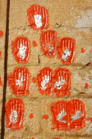 rajput: Hand prints of women who committed sati in Meherangarh Fort in Jodhpur, Rajasthan, India  Sati was ancient practice where a widowed Hindu women would immolate herself on her husbands funeral pyre