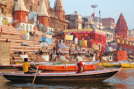 Varanasi,India,December 2,2012 - Hindu people are making ritual bathing at ghats   in holy Ganges River