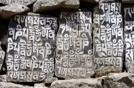 samsara: Buddhist mani stones with sacred mantras in Tibetan language,Nepal,Everest region