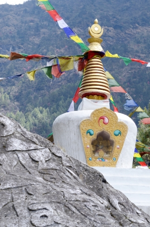 samsara: Small Tibetan stupa in Nepal with sacred mani stones Stock Photo