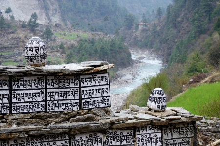 Buddhist mani stones with sacred mantras near Dudh Kosi river,Eastern Nepal, Everest region Zdjęcie Seryjne