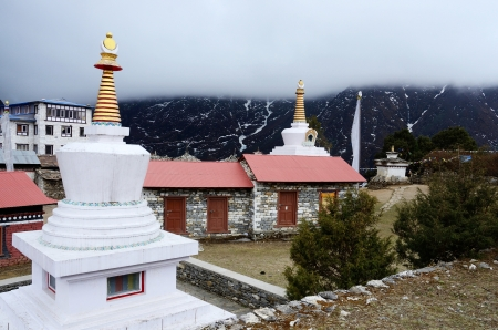samsara: Small stupas in Tengboche buddhist monastery covered with the cloud,Everest region,Nepal Stock Photo