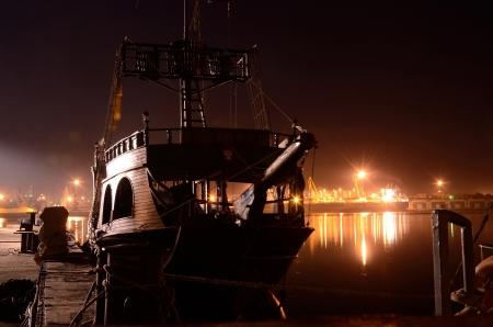 pirate crew: Old wooden ship at night ,Odessa port,Ukraine