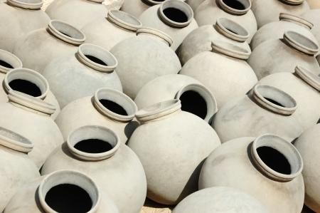 house ware: Big grey ceramic jars produced by Bishnou people,India,Rajasthan,Asia Stock Photo