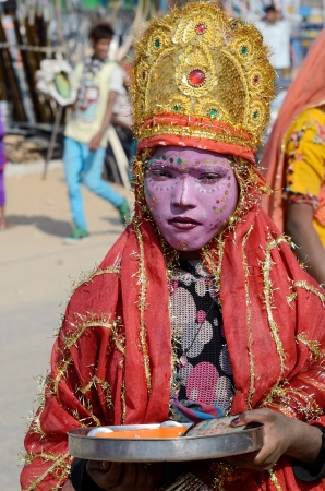 incarnation: Pushkar,India,November 12,2013 - boy dressed as Lord Krishna attends the Pushkar cattle fair, Rajasthan, India Krishna is eighth incarnation of Lord Vishnu in Hinduism