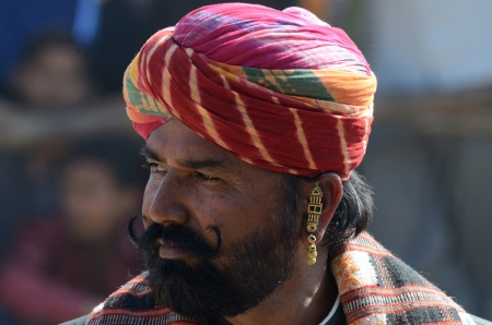 participant: Pushkar,India,November 14,2013 - participant shows his moustache at moustache competition at Pushkar cattle fair, Rajasthan, India  Editorial