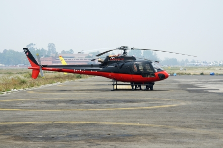 airfoil: Lukla airport,Nepal,April 14,2012 - rescue helicopter preparing to evacuate mountain climbers after accident from Everst Base Camp, Lukla airport, Nepal