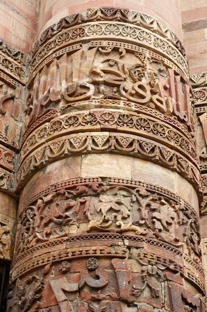 world heritage site: Closeup of Qutub tower in Delhi, made of red sandstone Qutb, the tallest minar in India, ancient Islamic Monument, decorated with Arabic inscriptions,  UNESCO World Heritage Site
