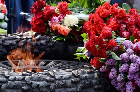 commemoration:  Flowers at the Eternal Flame in commemoration of Soviet soldiers  Stock Photo