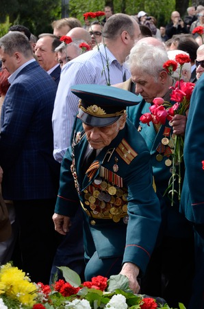 commemoration: Odessa,Ukraine,May 9,2014 - Old soldier come put flowers to Eternal Flame during celebration Victory Day in commemoration of Soviet soldiers who died during Great Patriotic War 1941-1945,Odessa,Ukraine