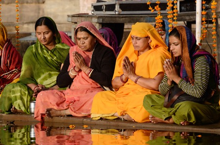 Pushkar,India,November 12,2013 - senior women perform puja - ritual ceremony at holy Pushkar Sarovar lake Pushkar - famous place of worship in India