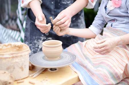 Hands working on throwing wheel, master class of studio pottery Stock Photo