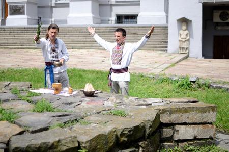 solemnize: Kiev,Ukraine,June 1,2014 - ukrainian pagan community making ritual ceremony dedicated to Perun,Slavic god of Thunder,near National Museum of History