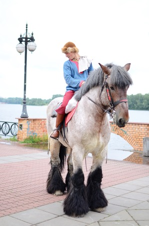 Kiev,Ukraine,May 31,2014 - man with carthorse preparing to performance during Day of Kiev holiday