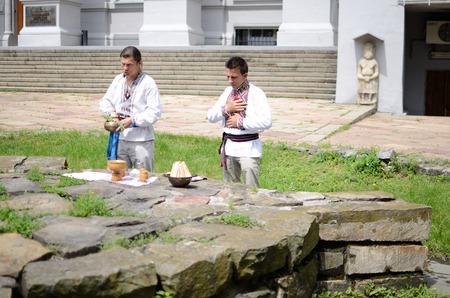 solemnize: Kiev,Ukraine,June 1,2014 - ukrainian pagan people making ritual ceremony dedicated to Perun,Slavic god of Thunder,near National Historical Museum Editorial