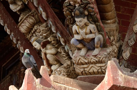 hindu gods: Hindu gods and dove - traditional wooden temple decoration,Nepal Asia Stock Photo
