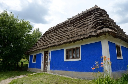 pise: Traditional old clay Ukrainian rural house - homestead with hay roof,Kadievcy  village,Podillya,Europe