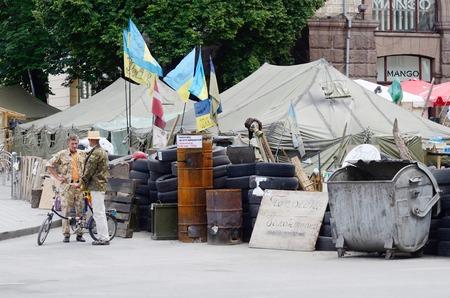 barricades: KIEV, UKRAINE - JUNE 19  Protesters tents with barricades at Maydan Nezalezhnosti square in Kiev after revolution 2013-2014, on June 19, 2014 in Kiev,Ukraine Editorial