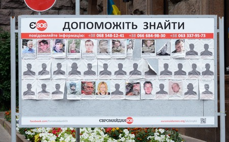 bulletin board: Kiev,Ukraine,June 19,2014 - Poster with photos of missing people ,saying  Help to find them  at Maydan Nezalezhnosti square after February revolution in Ukraine