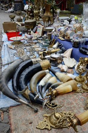 used items: Tbilisi,Georgia,September 16, 2014  -  Souvenirs and retro items sold on the Dry Bridge Market with traditional drinking horns used for wine on foreground in Tbilisi,Georgia