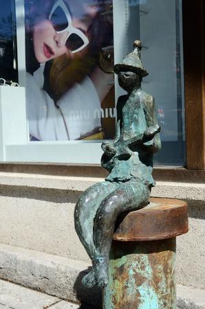 rustaveli: Tbilisi,Georgia,September 15, 2014 - Bronze statue of musician playing guitar on Rustaveli Avenue in old Tbilisi, Georgia.It is central avenue in Tbilisi named after the medieval Georgian poet, Shota Rustaveli Editorial