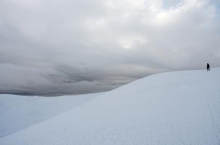 snow storm: Mountaineer standing on top of Gimba mountain during winter snow storm ,Carpathians,Western Ukraine Stock Photo