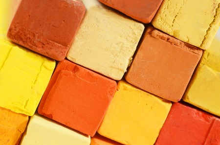 yellow ochre: Creative art background - closeup of bright pastel crayons with yellow,orange,red and ochre colours