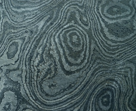damascus: Damascus steel with original pattern - forged metal,traditionally used for creating cold arms on Middle East Stock Photo