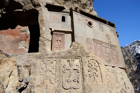 geghard: Cells of Geghard rock monastery with ancient khachkars ,Armenia, Caucasus. Stock Photo