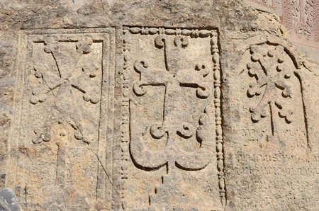 geghard: Stone steles with khachkars crosses and ancient armenian inscriptions Geghard monasterychristian artCentral Asia unesco heritage Stock Photo