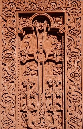 armenia: Stone carving - christian cross with floral ornament in Geghard rock monastery,Armenia,Caucasus,
