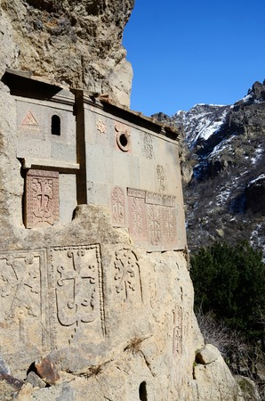 memorable: Cells of Geghard rock monastery with ancient khachkars - memorable crosses, ,Armenia, Caucasus,  Stock Photo