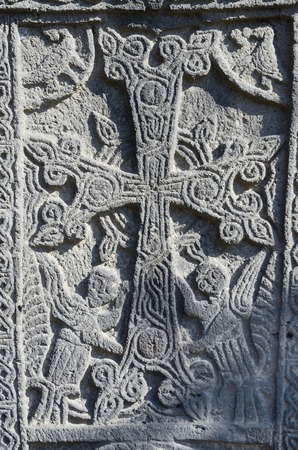mythical: Stone carving - christian cross with mythical creatures in Ejmiadzin ancient monastery ,Armenia,Caucasus,