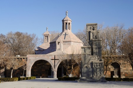 genocide: Saint Vartan Baptistery at Etchmiadzin church and Genocide Memorial Monument in Echmiadzin ArmeniaCentral Asia