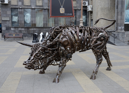 continuously: Erevan,Armenia,March 13,2015 - Bull art statue made from old iron mechanisms in old city center in Yerevan, Armenia.Yerevan is the capital and largest city of Armenia, and one of worlds oldest continuously inhabited cities