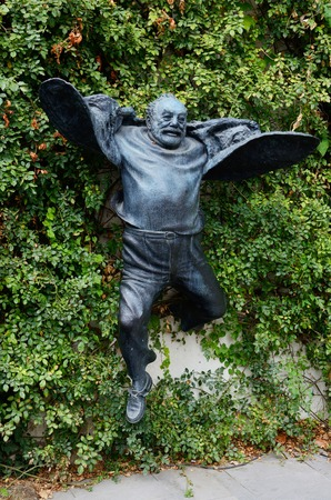 contributions: Tbilisi,Georgia,March 7,2015 -  Statue of jumping director Sergei Parajanov in old part of city on September 15, 2014 in Tbilisi. Paradzhanov - armenian film director and artist from the Soviet Union who made significant contributions to Ukrainian, Armeni