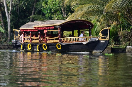 alappuzha: Alleppey,India,December 10,2015 -  An unidentified tourist boats at Kerala backwaters on December 10, 2013 in Alleppey,Kerala,India.Its a chain of lagoons and lakes lying parallel to Malabar Coast,famous natural landmark Editorial